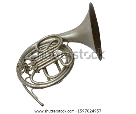 Old vintage silver French horn on a white background, isolated Royalty-Free Stock Photo #1597024957