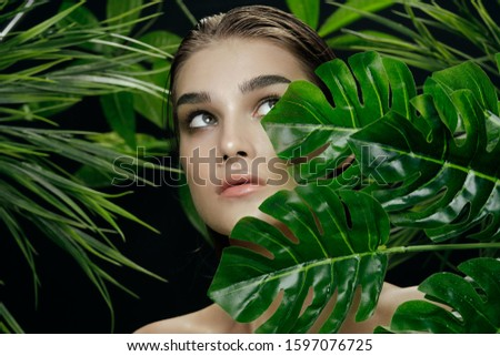 clear skin Charming lady palm leaves natural look #1597076725