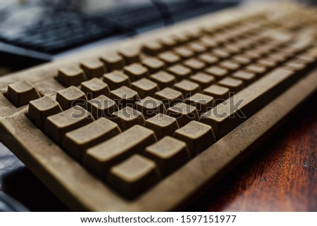 dusty computer keyboard. obsolete technology concept.  #1597151977