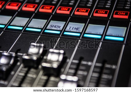 showtime sign in music studio or live concert on the digital or analog mixing desk dispalyed on the channel strip #1597168597