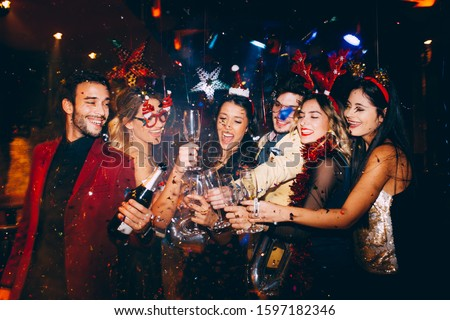 Group of friends having fun at New Year's party #1597182346