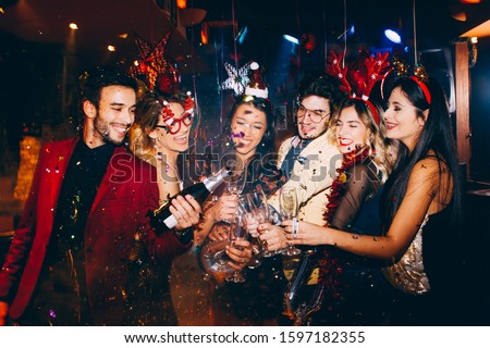Group of friends having fun at New Year's party #1597182355