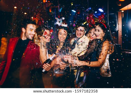 Group of friends having fun at New Year's party #1597182358