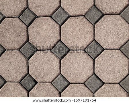The large orange-brown pedestrian surface is an 8-sided shape and has small squares. #1597191754