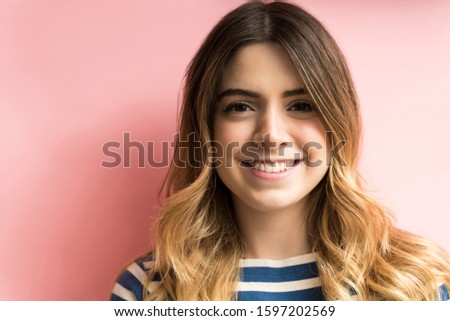 Closeup of pretty young woman with beautiful smile isolated on colored background #1597202569