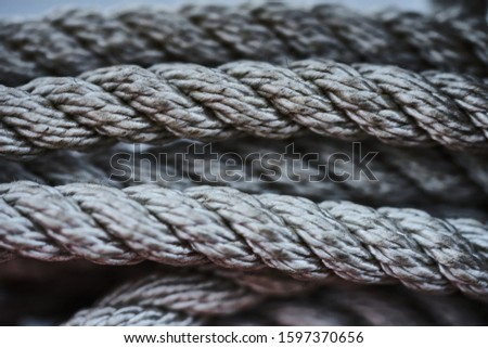 Close-up of an old frayed boat rope as a nautical background Royalty-Free Stock Photo #1597370656