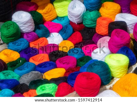 Ecuador, Colourful wool balls in the market of Guamote. #1597412914