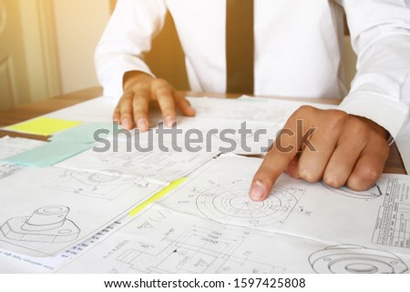 Businessman analysis investment perform data document and calculating. #1597425808