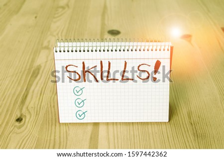 Handwriting text writing Skills. Concept meaning ability do something very well by nature Empty reminder wooden floor background spiral notebook groove slot office. #1597442362