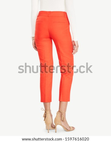 Blue formal pants for women's paired with orange full sleeve T-Shirt and flat footwear with white background, Blue formal pants for women's paired with orange full sleeve T-Shirt  #1597616020