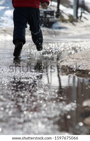 water,legs, boots ,blue trousers,red jacket, dripped, reflection, hides snow #1597675066