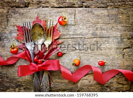 Thanksgiving table setting/ cutlery on the autumn background with autumn leaves,ribbon on wooden background/Thanksgiving holidays background concept #159768395