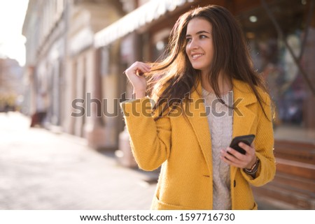 Portrait of a beautiful woman using a mobile #1597716730