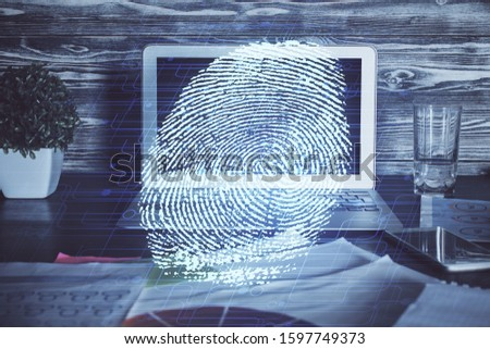 Computer on desktop in office with finger print drawing. Double exposure. Concept of business data security. #1597749373