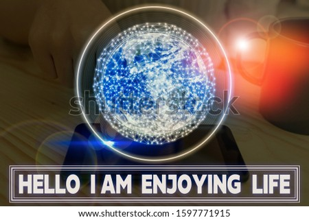 Writing note showing Hello I Am Enjoying Life. Business photo showcasing Happy relaxed lifestyle Enjoy simple things Elements of this image furnished by NASA. #1597771915