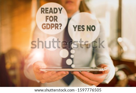 Conceptual hand writing showing Ready For Gdpr question Yes No. Business photo text Readiness General Data Protection Regulation Woman in the background pointing with finger in empty space. #1597776505
