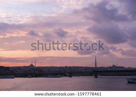 Sunset cityscape at Golden Horn, Istanbul. Historic city silhouette. #1597778461