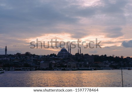 Sunset cityscape at Golden Horn, Istanbul. Historic city silhouette. #1597778464