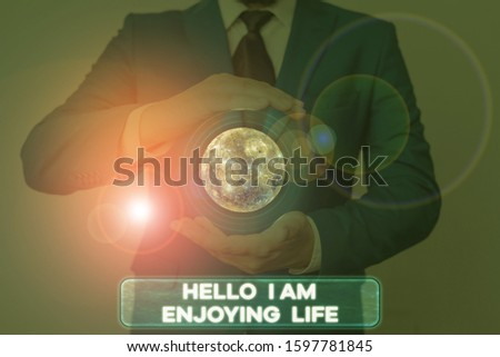 Word writing text Hello I Am Enjoying Life. Business concept for Happy relaxed lifestyle Enjoy simple things Elements of this image furnished by NASA. #1597781845