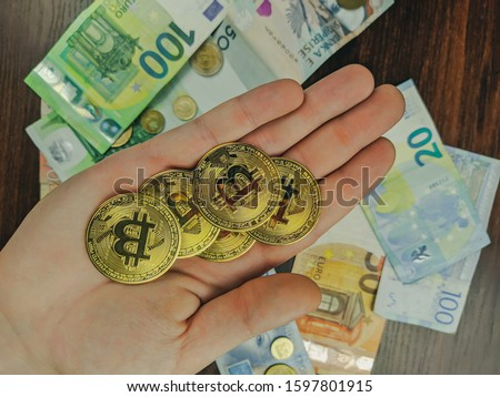 Handful of earned bitcoins used as a primary currency instead of a different choice of paper money and coins of various international currencies #1597801915