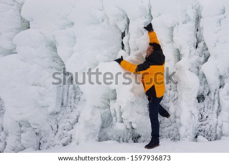A picture taken in a valley where cold winter snow and water are frozen.