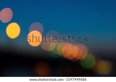 Defocused glowing light bulbs and bokeh effect. Effect bokeh background #1597949686