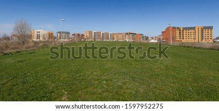 Panoramic view of polygon urban landscape or housing development, with empty lots to build