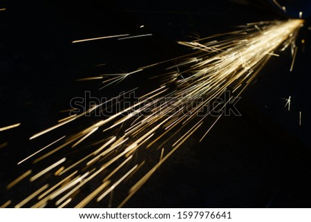 Hard job with sparks from abrasive grinder circle #1597976641