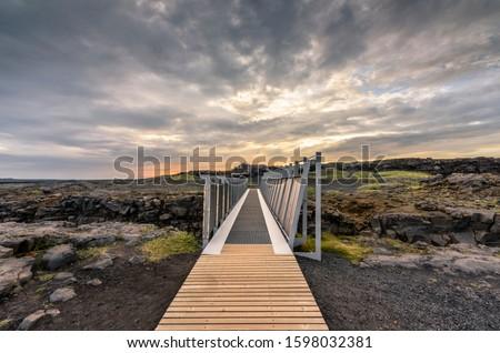 Midlina Bridge bridges the gap between the continental drift of Europe and North America, Sandvic, Reykjanes Peninsula, Iceland Royalty-Free Stock Photo #1598032381
