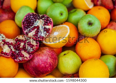 Fruit background, apples, opened pomegranate, orange, Delicious winter fruits on a stall, variety of healthy ripe fruits  #1598044300
