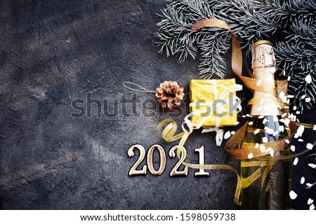 HAPPY NEW YEAR 2021 BACKGROUND OVER DARK STONE TABLE WITH HOLIDAYS DECORATIONS #1598059738