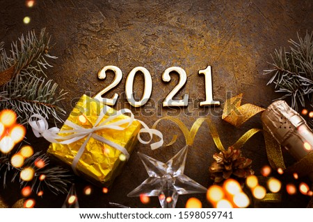 HAPPY NEW YEAR 2021 BACKGROUND OVER DARK STONE TABLE WITH HOLIDAYS DECORATIONS #1598059741