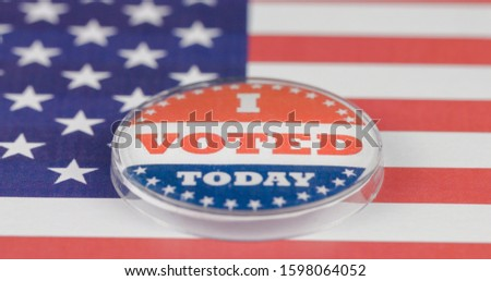 I voted today button on American flag. USA elections concept #1598064052