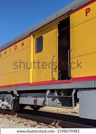 Yellow train car on the track #1598079481