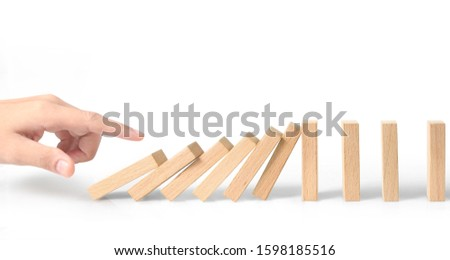 Hand stopping the Domino effect stopped by unique, Business Ideas #1598185516