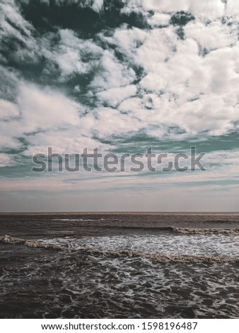 Sea and sky merging at horizon. I took this picture at Diu trip. Beautiful Cloudy weather.