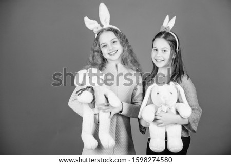 Hope love and joyful living. Friends little girls with bunny ears celebrate Easter. Children with bunny toys on blue background. Sisters smiling cute bunny costumes. Spread joy and happiness around. #1598274580