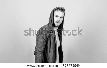 Unconventional but masculine look. Masculinity concept. Masculinity and confidence. Brute masculinity extremely commanding looking conventionally handsome. Man well groomed handsome hooded clothes. #1598275549