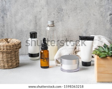 Set of female skin care products. Makeup products and skin cleansers on a gray background. Copy space