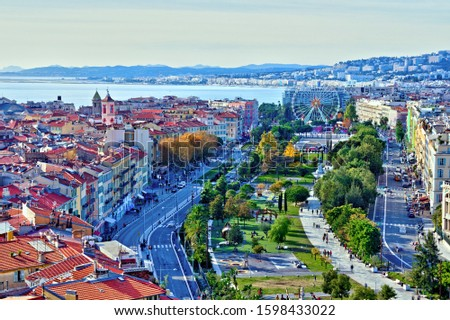 Colorful aerial panoramic view over the old town of Nice, France, with the famous Massena square and the Promenade du Paillon, from the roof of Saint Francis tower #1598433022