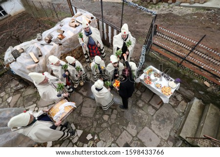 Gara Bov, Bulgaria - December 25, 2019: Festive holiday carols circumnavigate the houses of Bov village and sing Christmas songs. They wish the people from the village health, wealth and happiness. #1598433766