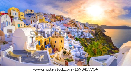 Oia town on Santorini island, Greece. Traditional and famous houses and churches with blue domes over the Caldera, Aegean sea #1598459734