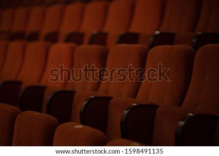 red velvet seats for spectators in the theater or cinema #1598491135
