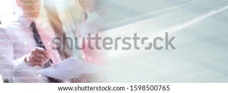 Senior manager working with executive assistant in office, double exposure, light effect; panoramic banner #1598500765