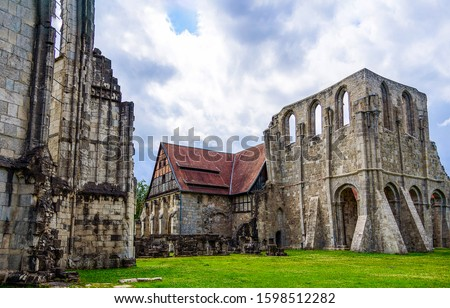 Ancient medieval castle ruins view. Castle ruins scene. Medieval castle ruins view. Castle ruins Royalty-Free Stock Photo #1598512282