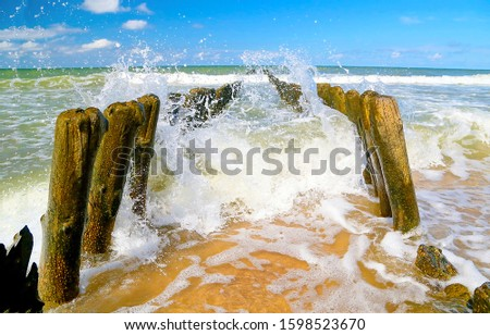 Splashing waves on shore. Waves splashing sea beach. #1598523670