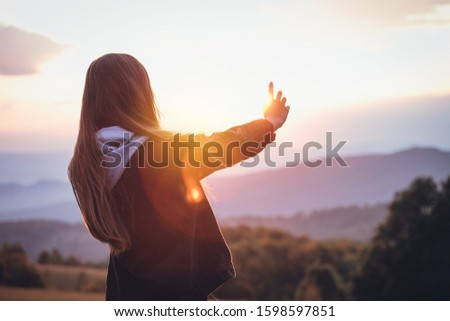 Young Prety Girl Outstretched Arm Covers the Sun #1598597851