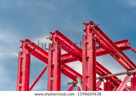 Red beams of a crossbar system against a blue sky #1598669638