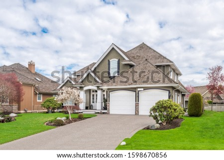 A perfect neighbourhood. Houses in suburb at Summer in the north America. Luxury houses with nice landscape. #1598670856