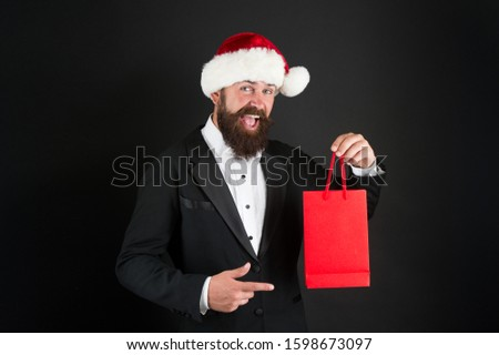 Product you should buy over Christmas holiday. Bearded man presenting product. Happy boss point finger at shopping bag. Product promotion. Christmas sale. Product advertising, copy space. #1598673097